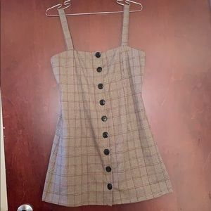 Plaid overall dress with buttons down middle